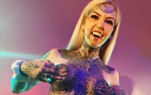 Blonde Bombshell Spends Thousands of Dollars on Tattoos, Body Mods (PHOTOS)