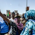 Sudan's military begins talks with protesters as curfew lifted