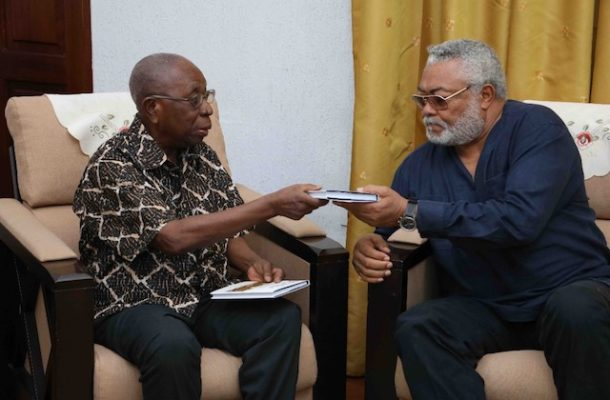 Ghana's first Clerk of Parliament presents books to Rawlings