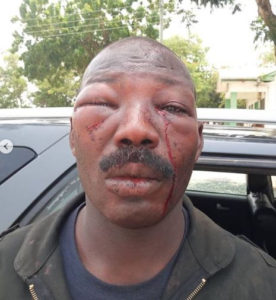 VIDEO: Police Officer embarrassingly defaced after receiving beatings from Amasaman residents