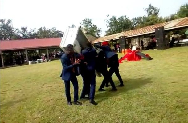 Corpse falls out of coffin during pallbearers' dance
