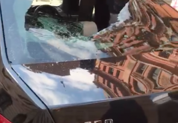 VIDEO: Nigerian man goes on rampage; destroys luxurious cars at UK High Commission