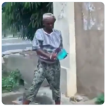 SHOCKING VIDEO: Woman caught washing plates by the roadside with 'gutter' water
