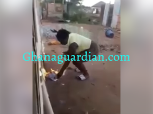 VIDEO: Ghanaian lady sets Bible aflame; says there's no power therein as claim