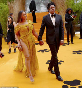 PHOTOS: Beyoncé commands attention in gold gown as she joins Jay-Z at premiere of The Lion King