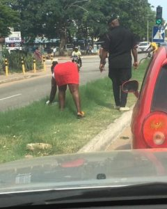 PHOTOS: Lady ordered by policeman to handpick for littering