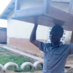 ENCHI: NDC chairman hailed for carrying a table on his head after primaries