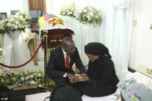 PHOTOS: Grace Mugabe sobs next to husband Robert's coffin