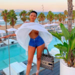 Huddah Monroe's boobs exposed as the wind lifted her top while she posed for a photo