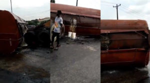 PHOTOS: Tanker filled with diesel falls on Otedola bridge, spills content across the road