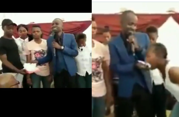 SHOCKING VIDEO: Pastor tears bible, feeds it to church members