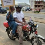 TOUCHING PHOTO: Physically challenged man hires 'okada' to join Ghanaian Muslim ladies protest