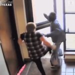 VIDEO: Elderly woman hailed after she was filmed bravely fighting off an armed bank robber
