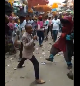 DRAMATIC VIDEO: Pastor and masquerade go toe-to-toe while 'evangelizing' in market square