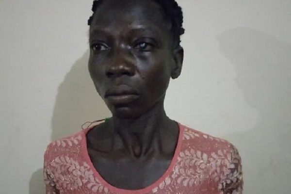 Woman clubs husband to death