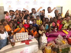 PHOTOS: Black Stars defender Jonathan Mensah makes donation to kids of Street Academy