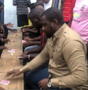 VIDEO: John Dumelo spotted playing cards with fans in his hood