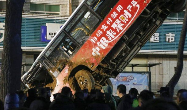China sinkhole: Six killed as ground swallows bus