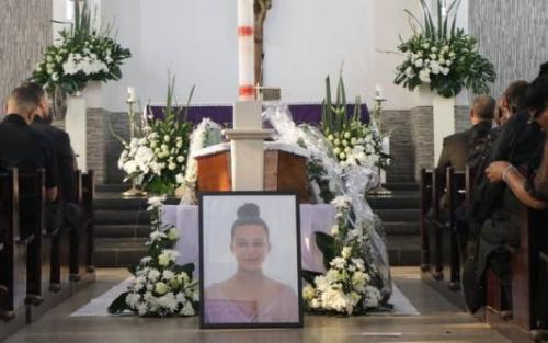 PHOTOS: Alex Mould's daughter laid to rest