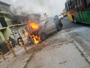 PHOTOS: Driver crashes into sidewalk as car catches fire at Mile 7