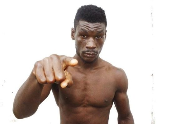 VIDEO: Boxer Patrick Allottey in trouble after beating football fan during Hearts vs Kotoko clash