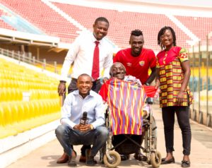 PHOTOS & VIDEO: Emmanuel Nettey presents signed Hearts jersey to physically challenged fan