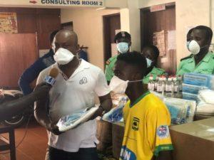 Kotoko teen sensation Mathew Anim Cudjoe presents medical supplies to CLOGSAG Polyclinic