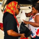 COVID-19: Edem and wife provide free meal to security personnel, share money to fans