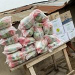 Majeed Ashimeru donates food items and hand sanitizers to the people of Nima
