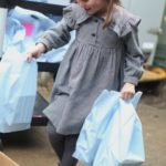 Princess Charlotte takes food to those in need as she turns five