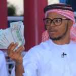 Bishop Obinim celebrates with $100 notes after release from Police custody