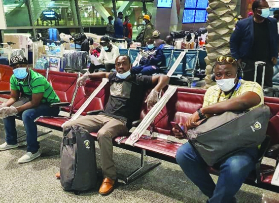 Ghanaians waiting to board their flight at HIA Friday
