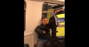UK Man Pepper-Sprayed After His Refusal to Wear Mask on Train Leads to Brawl With Police - Video
