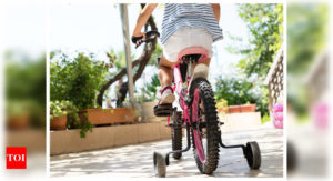 I am in no hurry to remove the training wheels from my 9-year-old daughter's cycle