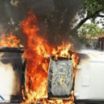 White South African farmers burn police vehicle, racially abuse gov't official in wake of murder