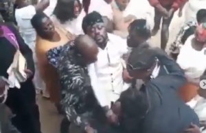 VIDEO: Beenie Man faints at mother's funeral
