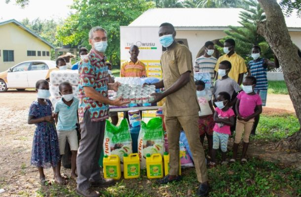 PHOTOS: Black Stars player Samuel Owusu donates to Elmina Orphanage