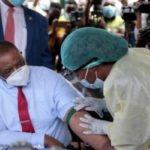Zimbabwe's Vice-President takes Chinese Vaccine