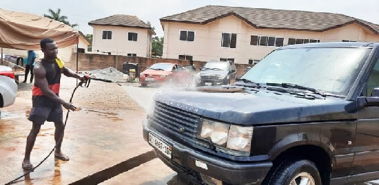 University graduate washes cars for a living; while waiting for better opportunity