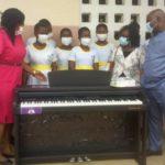 Michael Okyere Baafi donates digital pianos to Koforidua schools