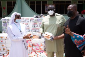 MD for State Housing Company and his NDC friend jointly donate to Martyrs of Uganda Prep. Sch. in Kumasi