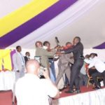 MPs trade blows as tempers flare up at a funeral