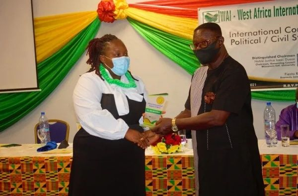 Dr Adu-Boateng of End Point Homeopathic Clinic receives prestigious Africa International Award of Merit