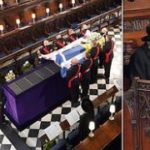 The Queen wipes away tears as she sits alone at Prince Philip's funeral