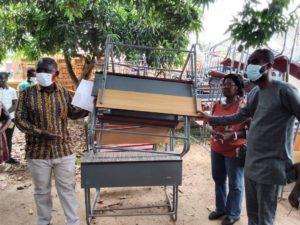 Nsawam-Adoagyiri MCE, Kwadwo Buabeng donates over 500 desks to schools