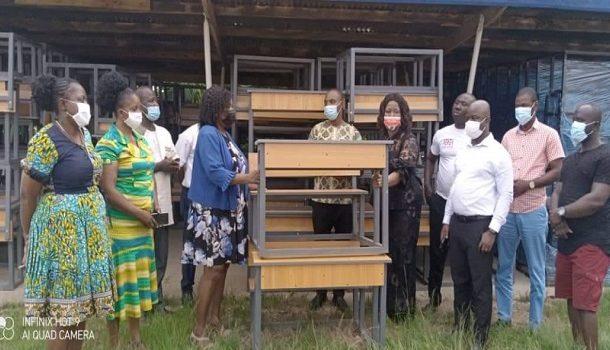 Suhum MCE, Margaret Darko presents dual desks to Education Directorate