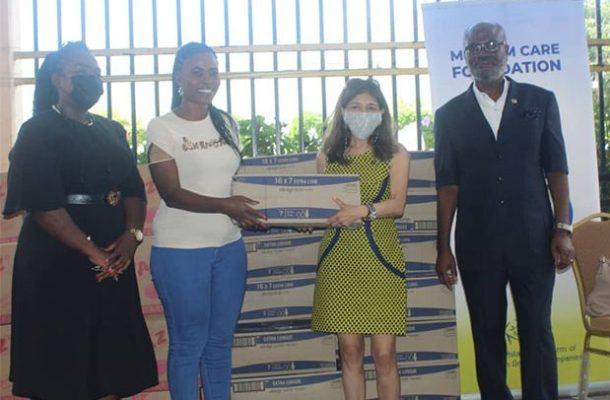 Melcom donates sanitary pads on world menstrual hygiene day