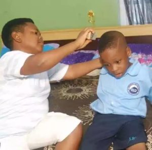 PHOTOS: Meet 38-year-old Nigerian actor Pawpaw and his son