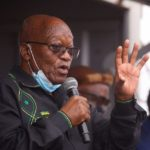 South Africa's Zuma tries to block arrest as police hold back