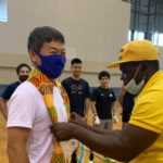 Black Bombers present Golden Tree Chocolate and stoles to Japanese Boxing Team